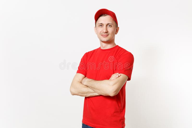 Delivery man in red uniform isolated on white background. Professional calm caucasian male in cap, t-shirt working as. Courier or dealer, holding hands crossed stock photography