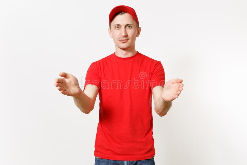 Delivery man in red uniform isolated on white background. Professional male in cap, t-shirt working as courier or dealer. Holding virtual object. Spreading royalty free stock image