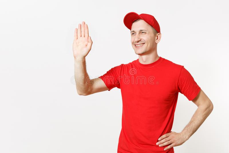 Delivery man in red uniform isolated on white background. Professional male in cap, t-shirt working as courier or dealer. Waving greeting with hand as notices stock photos