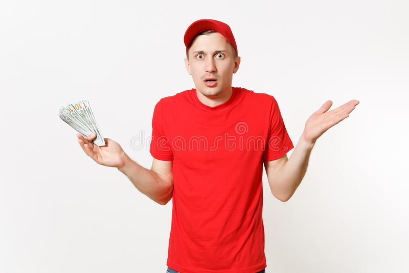Delivery man in red uniform isolated on white background. Professional shocked male in cap, t-shirt working as courier. Delivery man in red uniform isolated on royalty free stock photo