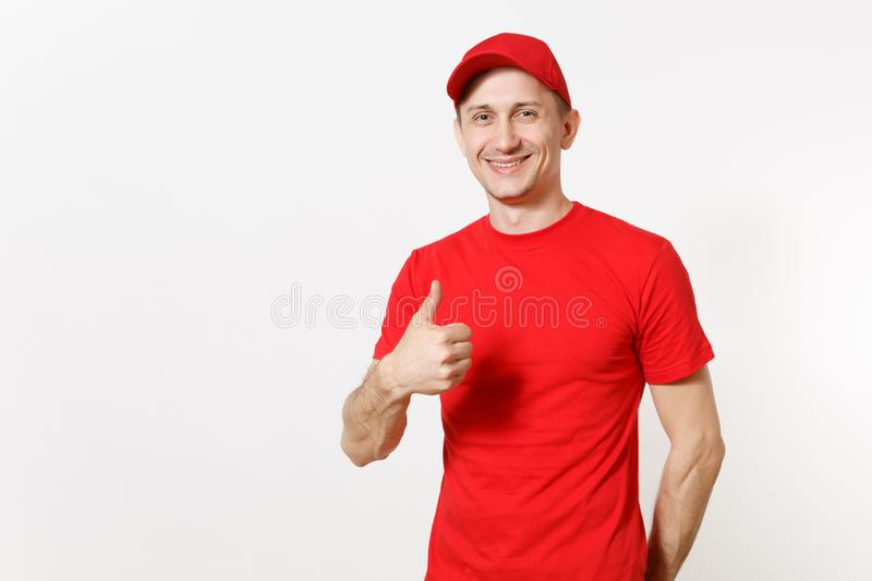 Delivery man in red uniform isolated on white background. Professional smiling caucasian male in cap, t-shirt working as. Courier or dealer, showing thumbs up royalty free stock photo