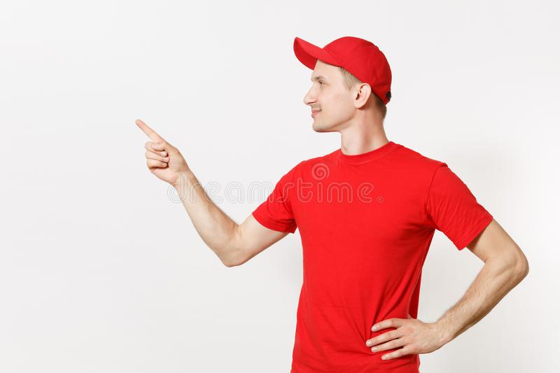 Delivery man in red uniform isolated on white background. Professional smiling male in cap, t-shirt working as courier. Or dealer, pointing index fingers aside stock photos