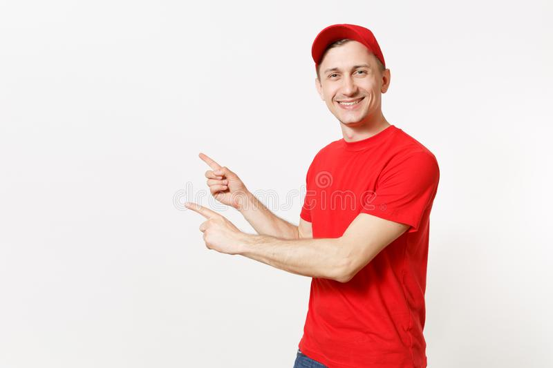Delivery man in red uniform isolated on white background. Professional smiling male in cap, t-shirt working as courier. Or dealer, pointing index fingers aside royalty free stock photography