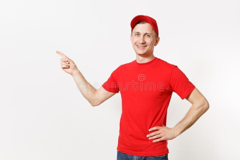 Delivery man in red uniform isolated on white background. Professional smiling male in cap, t-shirt working as courier. Or dealer, pointing index fingers aside royalty free stock image