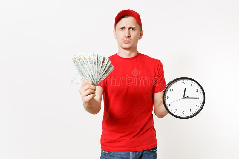 Delivery man in red uniform isolated on white background. Smiling male in cap, t-shirt, jeans working as courier or. Dealer, holding bundle of dollars cash royalty free stock photo