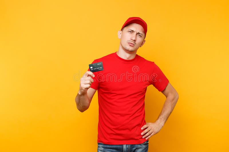 Delivery man in red uniform isolated on yellow orange background. Professional businesslike male employee in cap, t. Delivery man in red uniform isolated on stock photography
