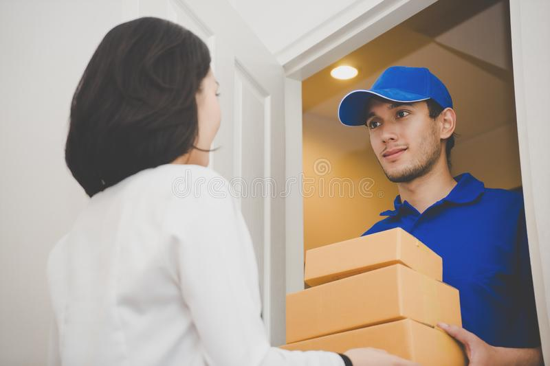 Delivery package to customer at the door royalty free stock photo