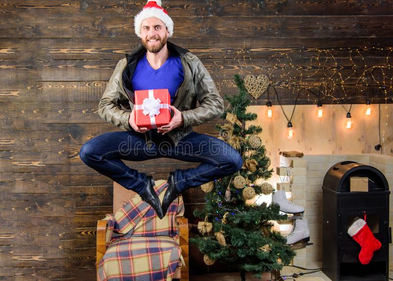 Delivery service. Gifts delivery. Man santa hat hurry to deliver gift on time. Christmas is coming. Spread happiness and royalty free stock image