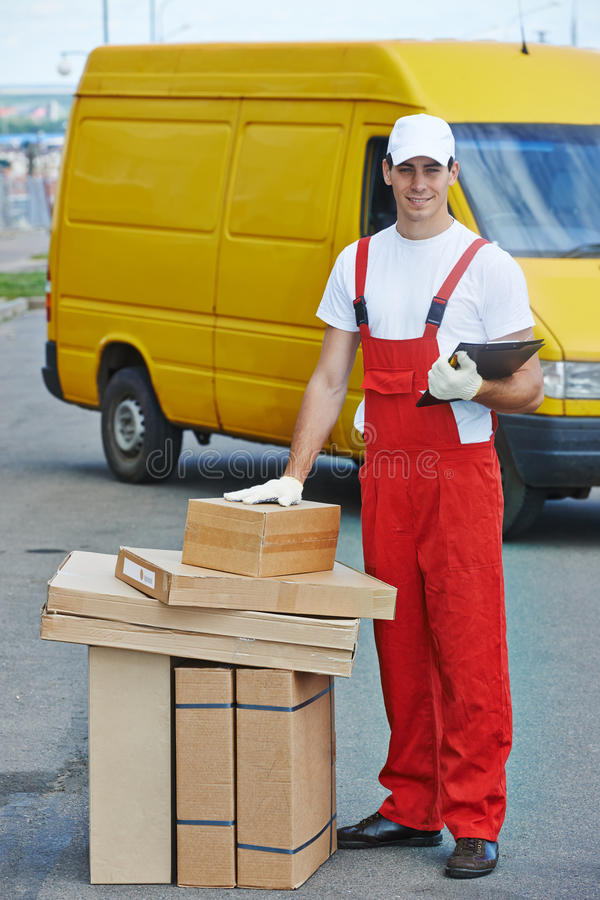 Delivery service. Man with parcel box royalty free stock image