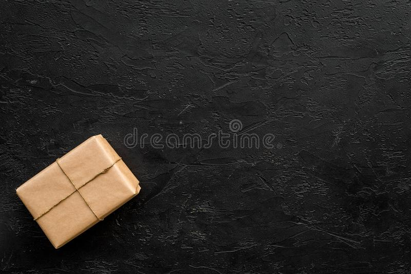 Delivery service office with cardboard box for courier on dark background top view mock-up royalty free stock photos