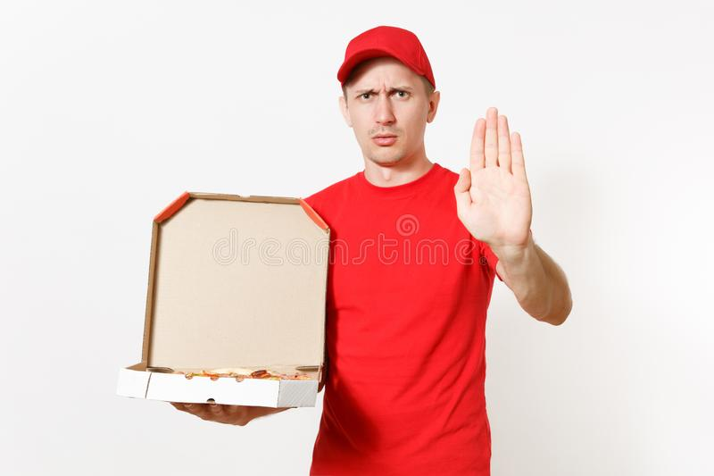 Delivery shocked man in red uniform isolated on white background. Male pizzaman in cap, t-shirt working as courier or. Dealer holding italian pizza in cardboard stock photography