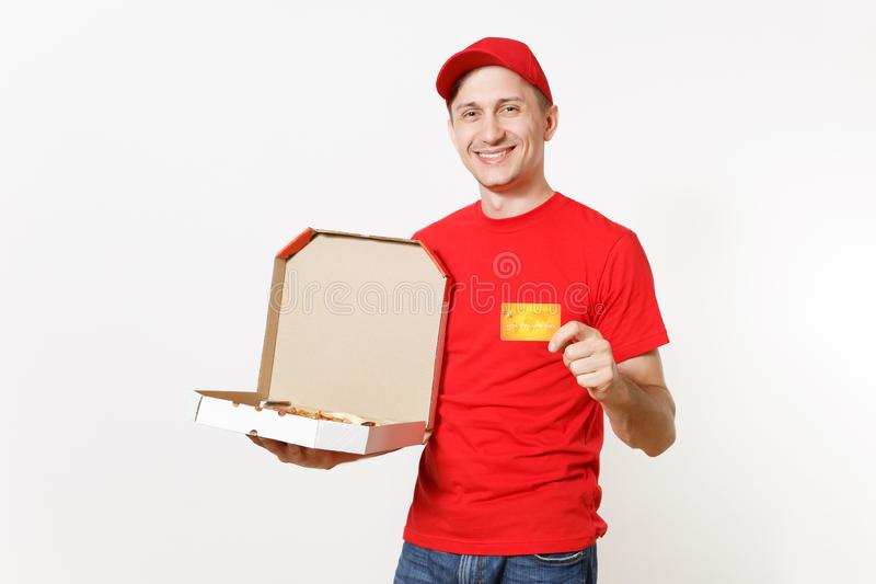 Delivery smiling man in red uniform isolated on white background. Male in cap, t-shirt working as courier holding. Italian pizza in cardboard flatbox and credit stock photos