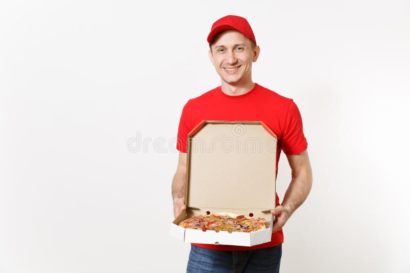 Delivery smiling man in red uniform isolated on white background. Male pizzaman in cap, t-shirt working as courier or stock images