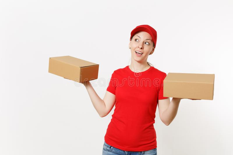 Delivery smiling woman in red uniform isolated on white background. Female in cap, t-shirt, jeans working as courier or. Dealer holding cardboard boxes stock photos