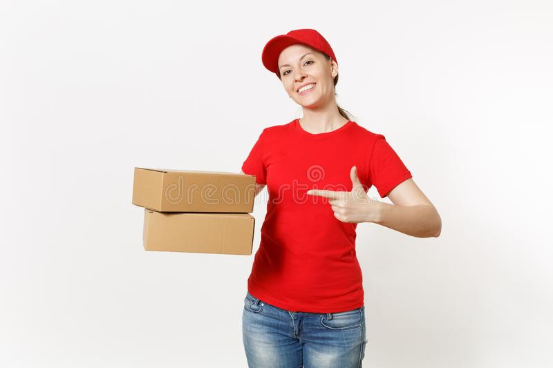 Delivery smiling woman in red uniform isolated on white background. Female in cap, t-shirt, jeans working as courier or. Dealer holding cardboard boxes royalty free stock images