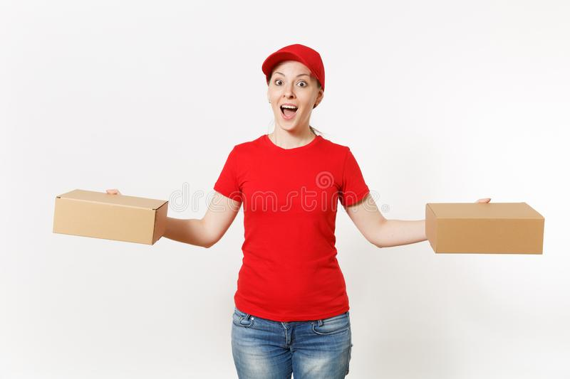 Delivery smiling woman in red uniform isolated on white background. Female in cap, t-shirt, jeans working as courier or. Dealer holding cardboard boxes royalty free stock photography