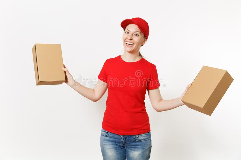 Delivery smiling woman in red uniform isolated on white background. Female in cap, t-shirt, jeans working as courier or. Dealer holding cardboard boxes stock image