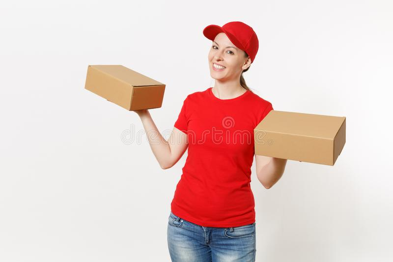 Delivery smiling woman in red uniform isolated on white background. Female in cap, t-shirt, jeans working as courier or. Dealer holding cardboard boxes royalty free stock image