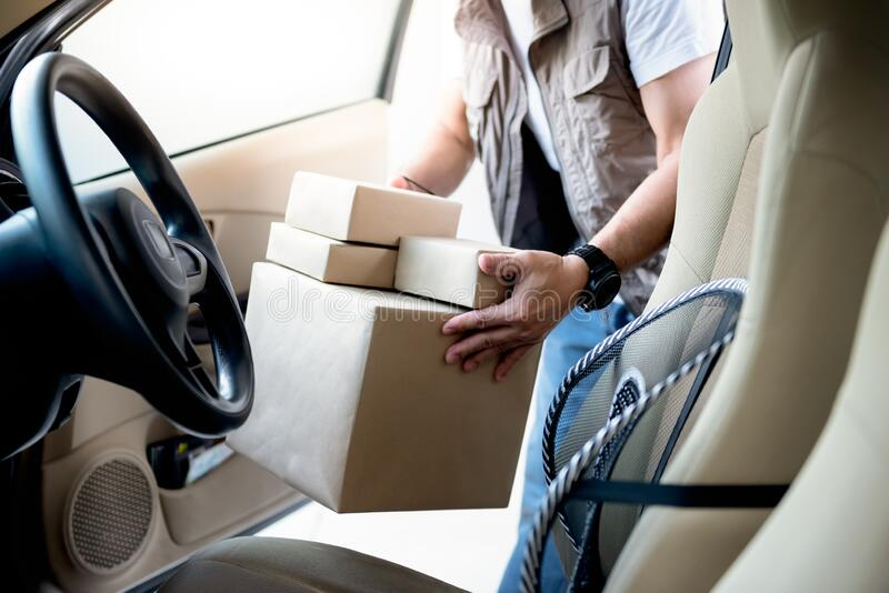 Delivery staff Taking the package out of the car to deliver to the customer. According to the online order, concept to transport and delivery services in a new royalty free stock photos