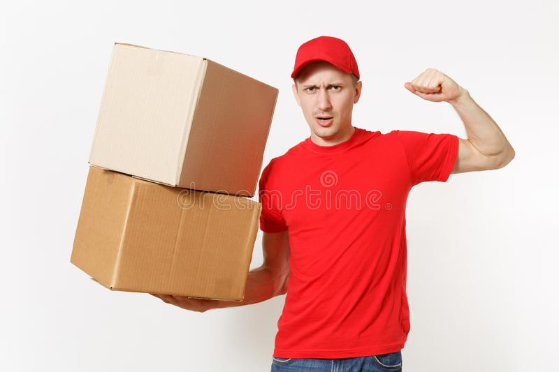 Delivery strong man in red uniform isolated on white background. Male in cap, t-shirt courier showing biceps, muscles stock image