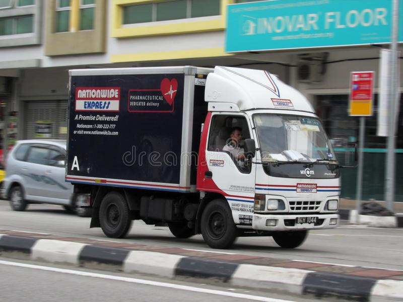 Delivery Van Of Nationwide Express - With Motion Blur. The delivery van of one of Malaysia`s leading courier delivery company Nationwide Express Pharmaceutical stock photography