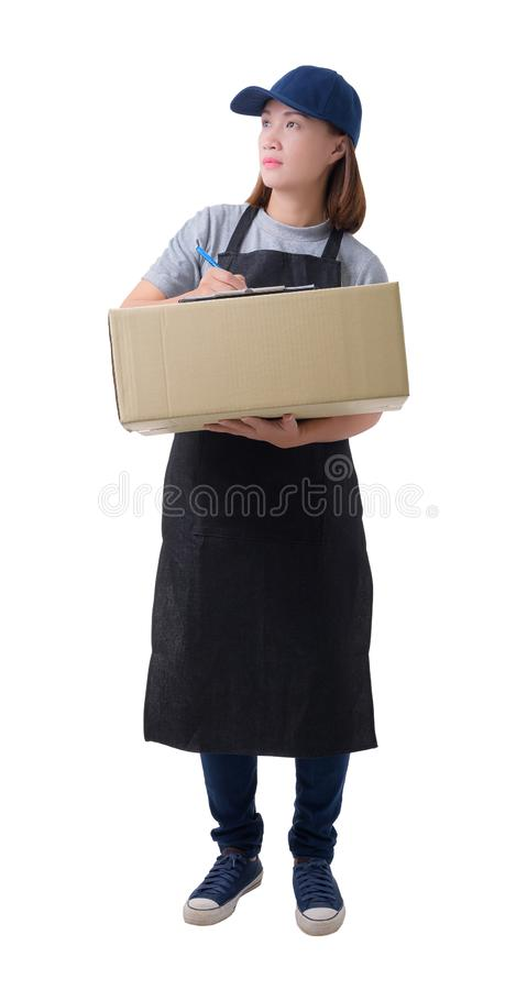 Delivery woman in Gray shirt and apron with stack of boxes is carrying parcel and presenting receiving form isolated. Full Body portrait of delivery woman in royalty free stock photos