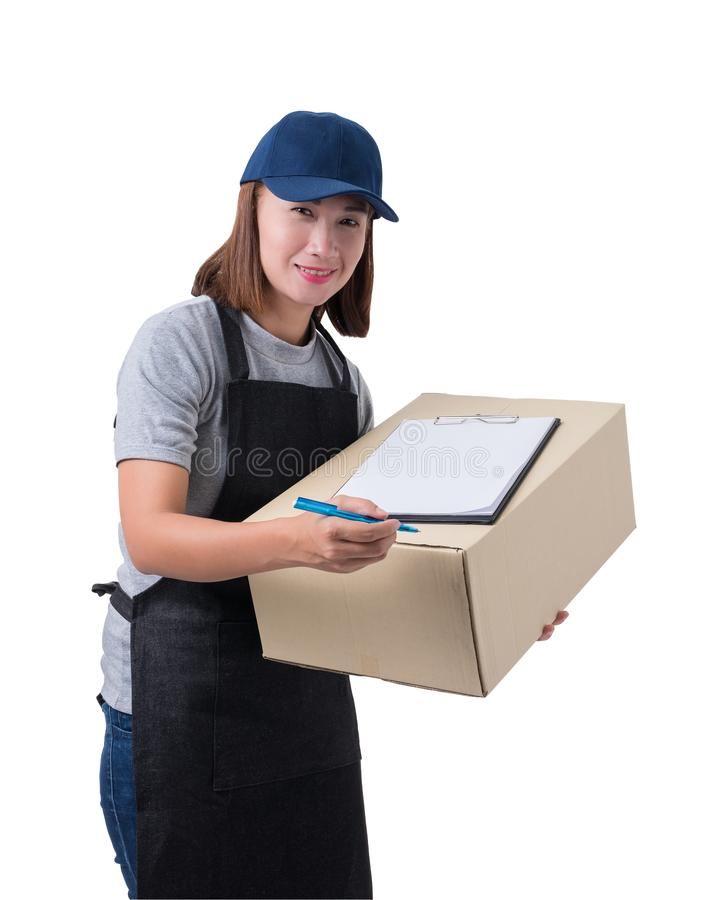 Delivery woman in Gray shirt and apron with stack of boxes is carrying parcel and presenting receiving form isolated. Portrait of delivery woman in Gray shirt royalty free stock images