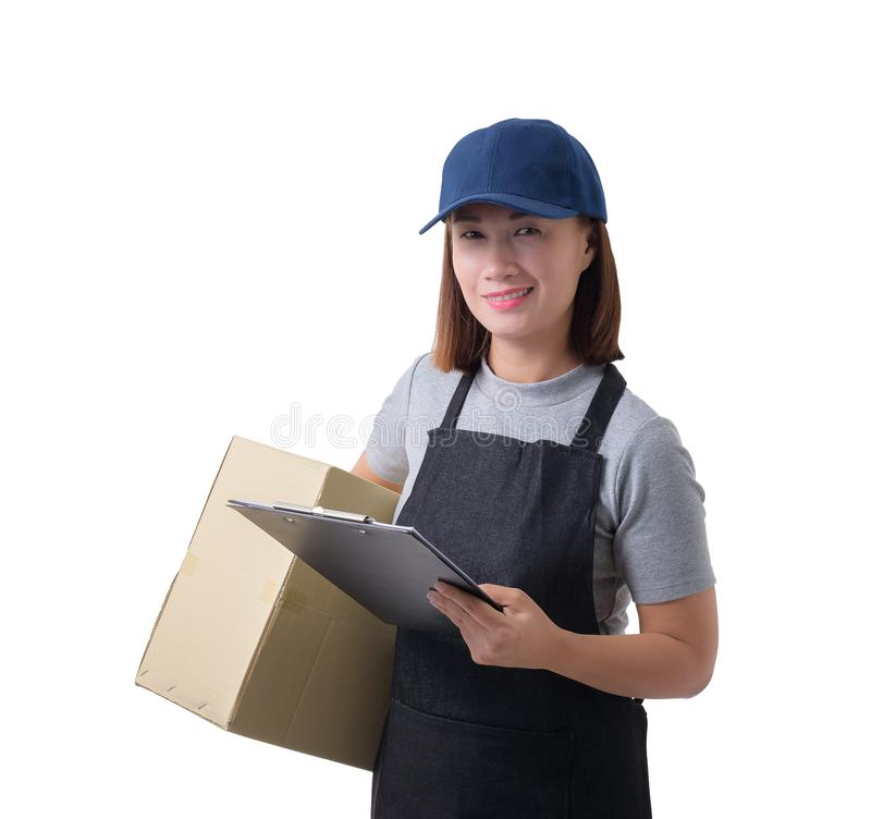 Delivery woman in Gray shirt and apron with stack of boxes is carrying parcel and presenting receiving form isolated. Portrait of delivery woman in Gray shirt royalty free stock image