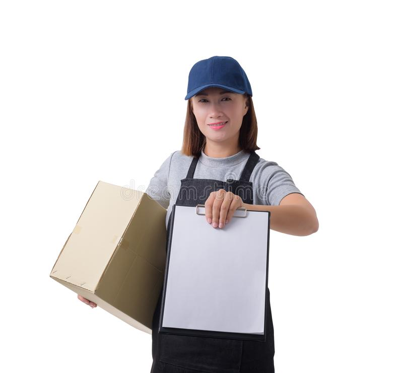Delivery woman in Gray shirt and apron with stack of boxes is carrying parcel and presenting receiving form isolated. Portrait of delivery woman in Gray shirt stock images