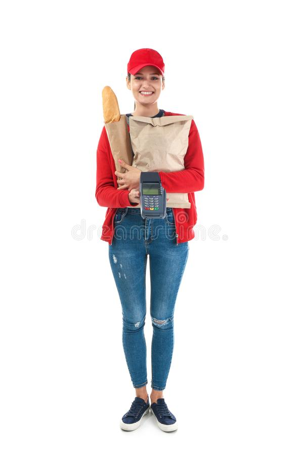 Delivery woman holding paper bag with food and payment terminal on white background royalty free stock photo