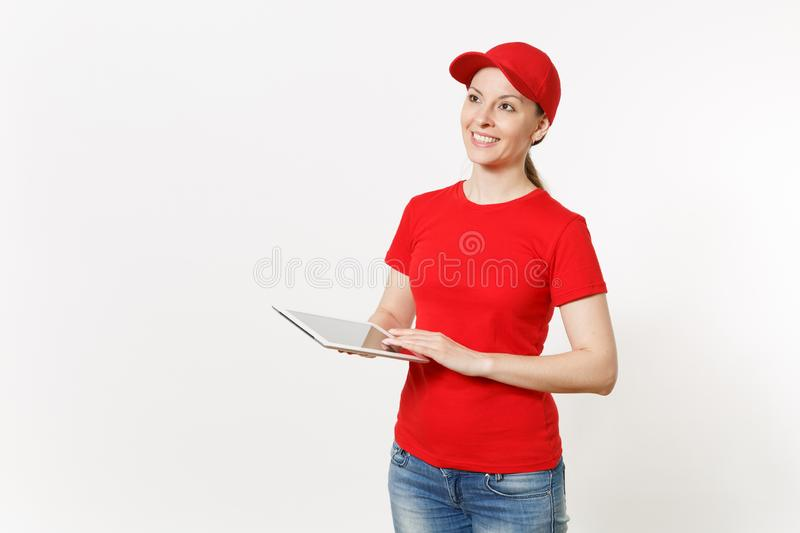 Delivery woman in red uniform isolated on white background. Female in cap, t-shirt, jeans working as courier or dealer stock photo
