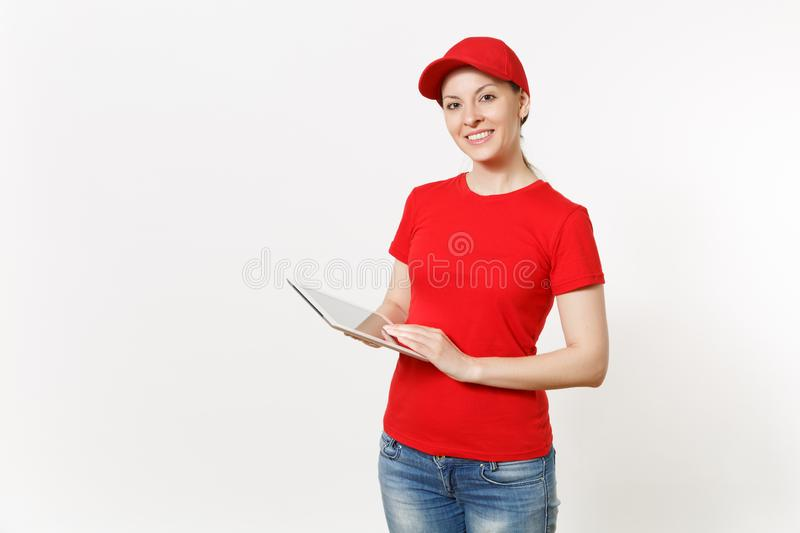Delivery woman in red uniform isolated on white background. Female in cap, t-shirt, jeans working as courier or dealer stock photos