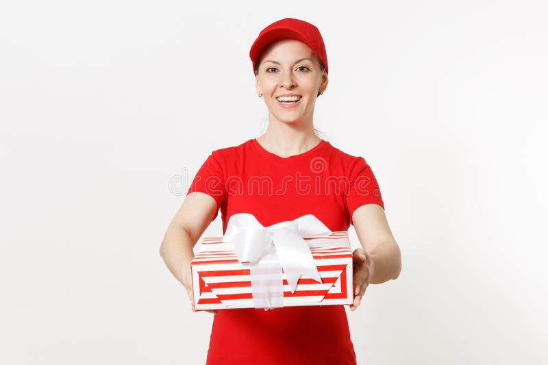 Delivery woman in red uniform isolated on white background. Smiling female in cap, t-shirt, jeans working as courier or. Delivery woman in red uniform isolated stock photo