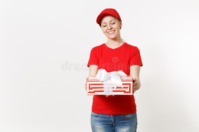 Delivery woman in red uniform isolated on white background. Smiling female in cap, t-shirt, jeans working as courier or. Delivery woman in red uniform isolated royalty free stock images