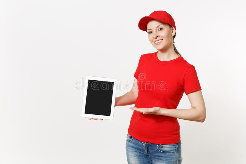 Delivery woman in red uniform isolated on white background. Smiling female in cap, t-shirt, jeans working as courier or. Delivery woman in red uniform isolated royalty free stock photo