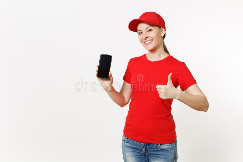 Delivery woman in red uniform isolated on white background. Female in cap, t-shirt, jeans working as courier or dealer. Showing on camera mobile phone with stock image
