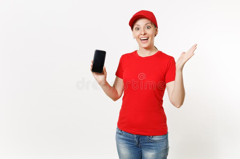 Delivery woman in red uniform isolated on white background. Female in cap, t-shirt, jeans working as courier or dealer. Showing on camera mobile phone with stock images