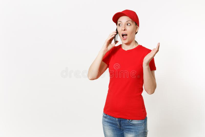 Delivery woman in red uniform isolated on white background. Female in cap, t-shirt, jeans working as courier or dealer. Talking on mobile phone, speaking stock photos