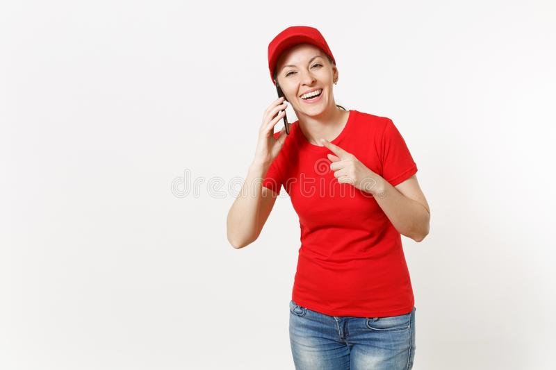 Delivery woman in red uniform isolated on white background. Female in cap, t-shirt, jeans working as courier or dealer. Talking on mobile phone, speaking royalty free stock photography