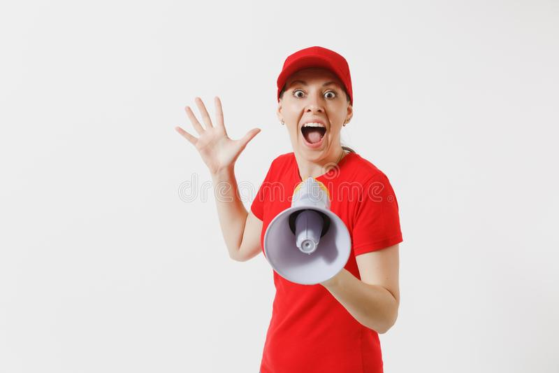 Delivery woman in red uniform isolated on white background. Female in cap, t-shirt working as courier screaming in. Megaphone hot news. Fun girl announces royalty free stock images