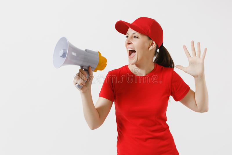 Delivery woman in red uniform isolated on white background. Female in cap, t-shirt working as courier screaming in. Megaphone hot news. Fun girl announces royalty free stock photos