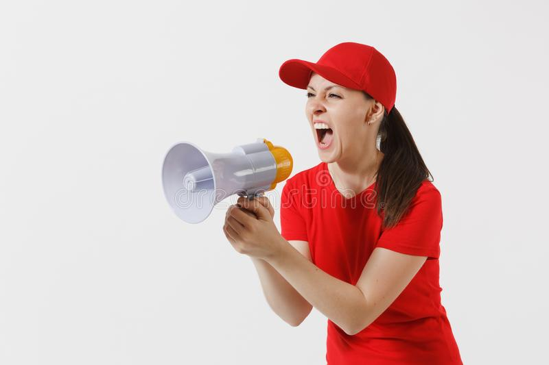 Delivery woman in red uniform isolated on white background. Female in cap, t-shirt working as courier screaming in. Megaphone hot news. Fun girl announces stock photo