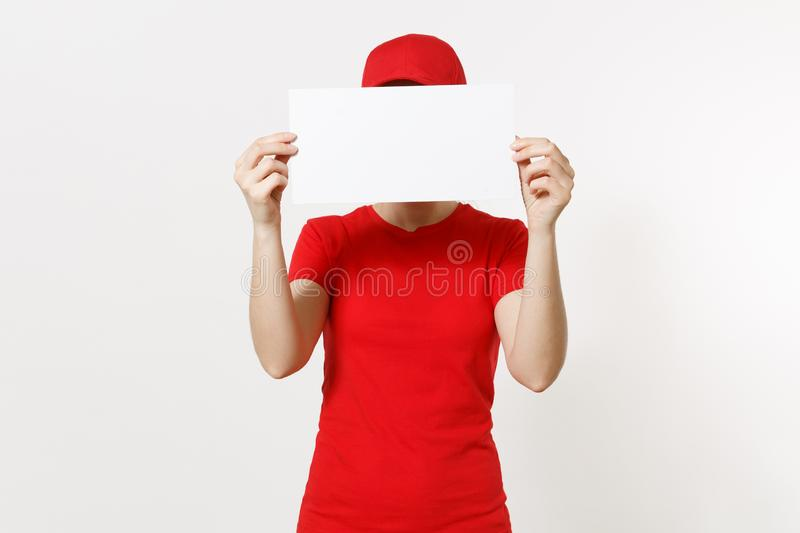 Delivery woman in red uniform isolated on white background. Female courier in cap, t-shirt, jeans holding white empty stock images