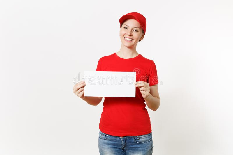 Delivery woman in red uniform isolated on white background. Female courier in cap, t-shirt, jeans holding white empty. Blank paper. Copy space advertisement royalty free stock images