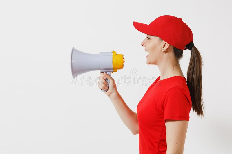 Delivery woman in red uniform isolated on white background. Female courier in cap, t-shirt screaming in megaphone hot royalty free stock images