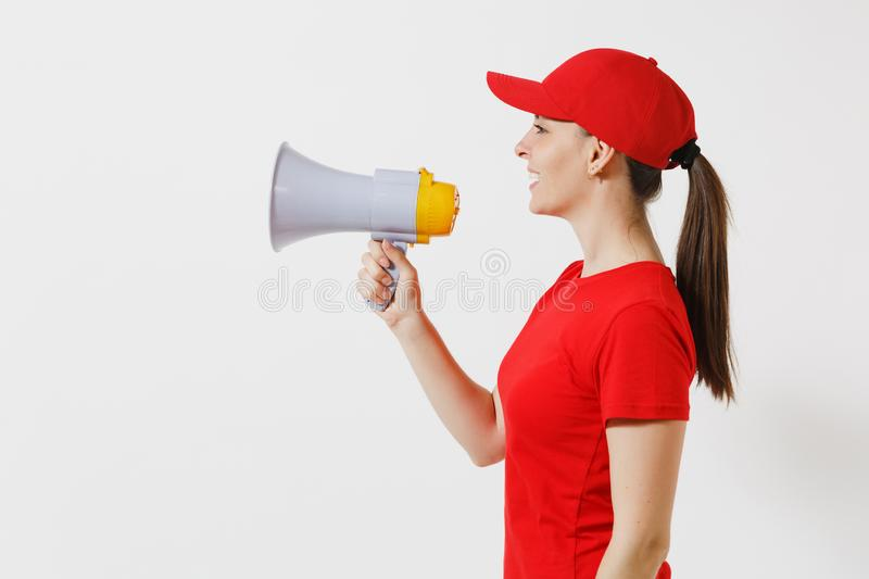 Delivery woman in red uniform isolated on white background. Female courier in cap, t-shirt screaming in megaphone hot. News. Fun girl announces discounts sale royalty free stock image