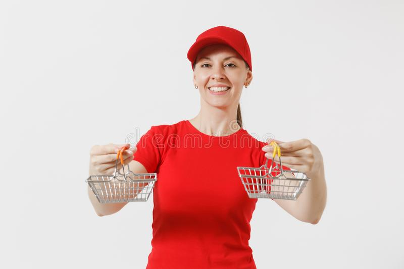 Delivery woman in red uniform isolated on white background. Female courier or dealer in cap, t-shirt, jeans holding. Metal grocery basket for shopping in royalty free stock images