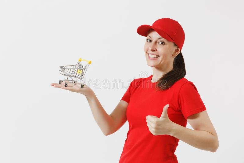 Delivery woman in red uniform isolated on white background. Female courier or dealer in cap, t-shirt, jeans holding. Supermarket grocery push cart for shopping stock photos