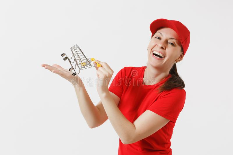 Delivery woman in red uniform isolated on white background. Female courier or dealer in cap, t-shirt, jeans holding. Supermarket grocery push cart for shopping stock images