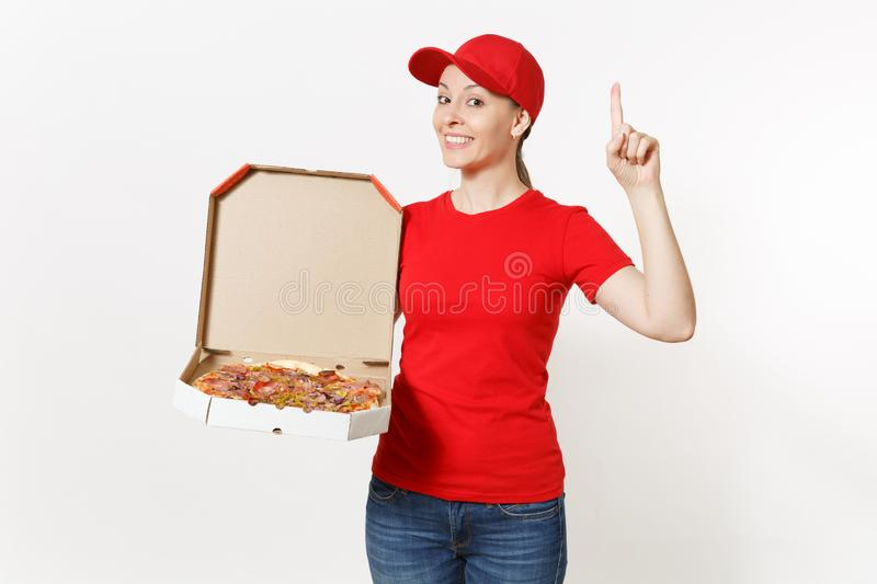 Delivery woman in red uniform isolated on white background. Pretty female in cap, t-shirt, jeans working as courier or. Dealer holding italian pizza in royalty free stock image